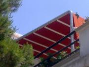 Tende e tensotende modello attico con scorrimento su binari motorizzate o manuale 1