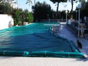 Coperture elettrosaldate per piscine con tubolari salsicciotti laterali di ancoraggio in PVC 650gr./mtq