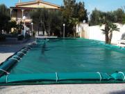 Coperture per piscine con tubolari laterali di ancoraggio in PVC 650gr./mtq elettrosaldato