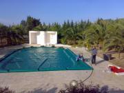 Coperture per piscine con valvola di scarico